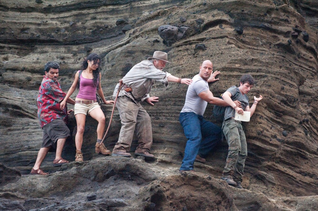 "(L-r) LUIS GUZMÁN as Gabato, VANESSA HUDGENS as Kailani, MICHAEL CAINE as Alexander, DWAYNE JOHNSON as Hank, and JOSH HUTCHERSON as Sean in New Line Cinema's family adventure ""JOURNEY 2: THE MYSTERIOUS ISLAND,"" a Warner Bros. Pictures release. Photo by Ron Phillips"